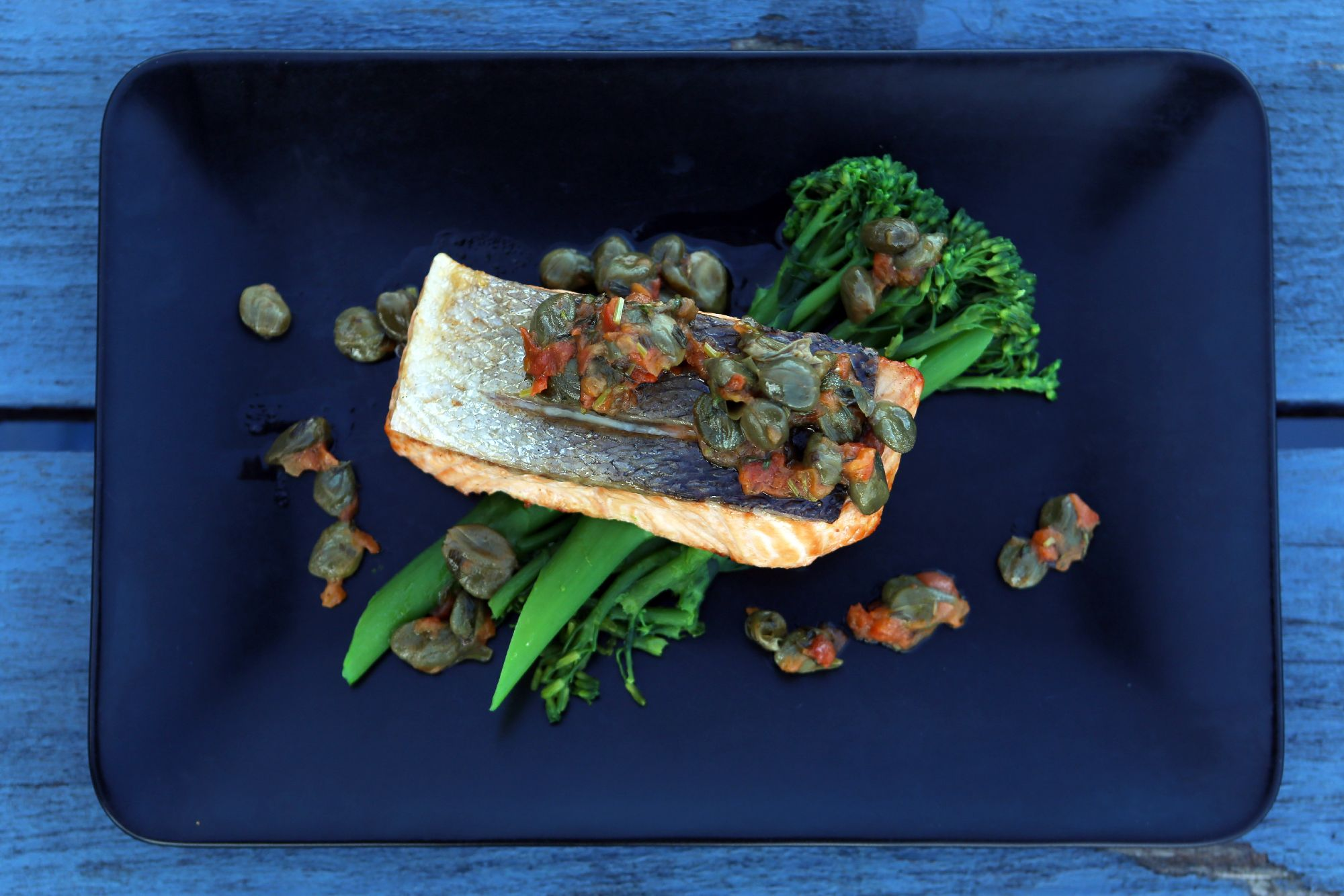 Salmon Pan-fried, long stem broccoli, tomato and caper vinaigrette